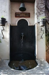 Historic Mission Bell above fountain at La Arcada Santa Barbara.jpg